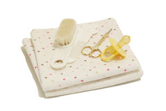 Diapers, nail scissors, combs and nipple. On white background Stock Images