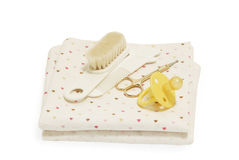 Diapers, nail scissors, combs and nipple. On white background Stock Image