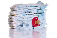 Diapers. With pacifier and Baby shoes Royalty Free Stock Photography