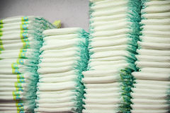 Diapers stacked in a piles stock photos