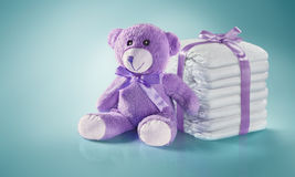 Diapers and Teddy bear. Baby background. Diapers and Teddy bear. Present woth the ribbon royalty free stock image