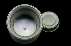 The diaphragm of a camera lens aperture. The diaphragm of a camera lens aperture on black background Royalty Free Stock Photos