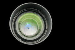 The diaphragm of a camera lens aperture. The diaphragm of a camera lens aperture on black background Royalty Free Stock Images