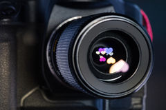The diaphragm of a camera lens aperture. Color toned image. New Royalty Free Stock Images