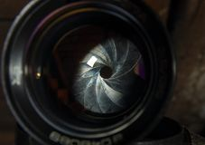 Diaphragm of a camera lens aperture. Camera diaphragm aperture with flare and reflection on lens Stock Photo