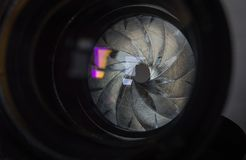 Diaphragm of a camera lens aperture. Camera diaphragm aperture with flare and reflection on lens Royalty Free Stock Photography
