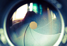 The diaphragm of a camera lens aperture. Selective focus with shallow depth of field. Color toned image Stock Images