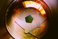 The diaphragm of lens aperture with flare. Selective focus with. Shallow depth of field. Vintage filtered image tone. Conceptual of concentration Stock Photo