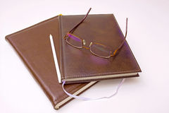 Diaries. Worktable with the diaries and glasses on it, photography Royalty Free Stock Photos
