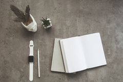 Diaries and modern watch on workplace Royalty Free Stock Photos