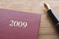 Diario 2009 y pluma Imágenes de archivo libres de regalías