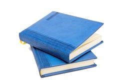 Diario azul encima de la antera una Fotografía de archivo