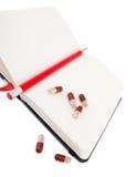Diario de la salud con las vitaminas Imágenes de archivo libres de regalías