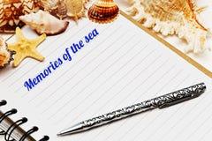 Diario en blanco con las cáscaras del mar Imagen de archivo libre de regalías
