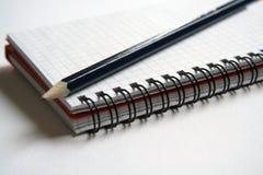 Diario y lápiz Imágenes de archivo libres de regalías