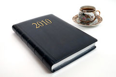 Diario y taza de café Imágenes de archivo libres de regalías