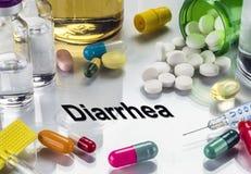 Diarrea, medicine come concetto del trattamento ordinario Immagini Stock