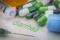Diarrhea, medicines and syringes as concept. Of ordinary treatment health Stock Photography