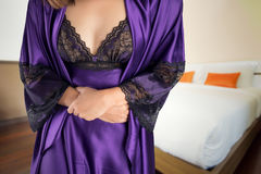 Diarrhea. The woman in  purple satin nightgown wake up for go to restroom. People with diarrhea problem concept Stock Image