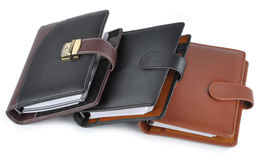 Diary. Closed black and brown color diaries Royalty Free Stock Photography