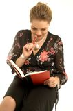 Diary. Lovely girl with red diary book Royalty Free Stock Photography
