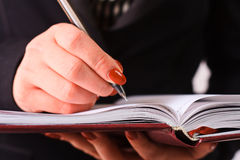 Diary. Red diary in women hands Royalty Free Stock Images
