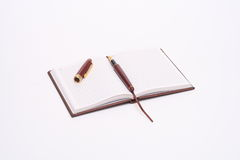 Diary. Opened diary with a pen royalty free stock photography