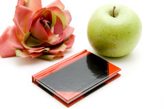 Diary. With flower and apple stock photography