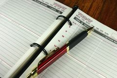 Diary. Open diary with pen ready to make appointments Stock Images