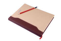 Diary. Sharp pencil on a diary isolated, white background Stock Photo