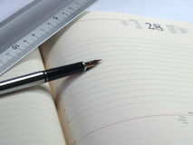 Diary. Notebook and pen royalty free stock image