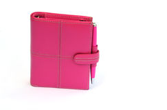 Diary. Shot of a pink personal organiser on white Stock Photo