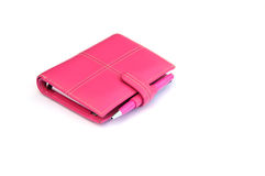 Diary. Shot of a pink personal organiser on white Royalty Free Stock Photo