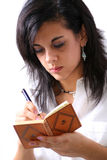 The diary. The young woman write on her diary Stock Image