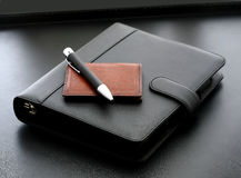Diary. A diary on a desk with a pen and a wallet Stock Photo