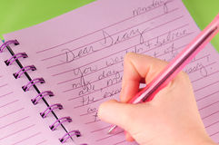 Diary. Young girl writing in diary Stock Photography