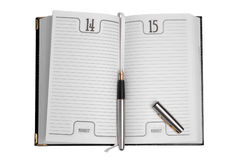 Diary. And a pen on white background Stock Image