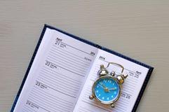 Diary an alarm clock Royalty Free Stock Photography