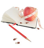Diary with apple and pills for effective dieting Stock Photography