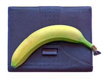 The braun leather diary with banana on it. The braun leather diary and banana on it.White background,halftone image Stock Image
