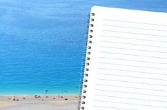 Diary and the beach Royalty Free Stock Image