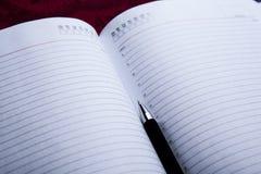 Diary with black pen Stock Photo