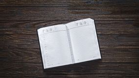 Diary, blank, pages,business planning, business, daily routine, freelancing. Open diary with blank pages on a wooden vintage table. Concept: business planning royalty free stock photos