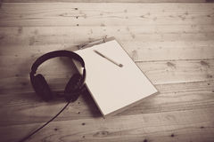 Diary. Blank diary and pen earphone on wood background Stock Photo