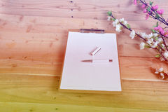 Diary. Blank diary and pen on wood background Royalty Free Stock Image