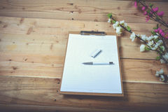Diary. Blank diary and pen on wood background Royalty Free Stock Photos