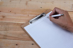 Diary. Blank diary and pen on wood background Royalty Free Stock Photography