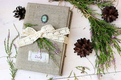 Diary book with bunch of erica and piny cones Stock Images