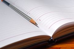 Diary book and pencil Royalty Free Stock Photo