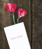 Diary with bookmark two hearts on wooden floor Stock Photo